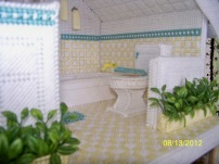 The bathroom, complete with wallpaper and towel bars.