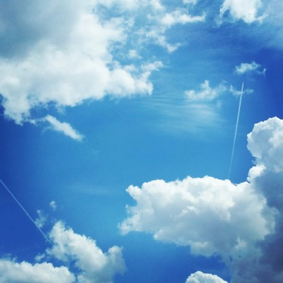 Airplanes flitting through the clouds.