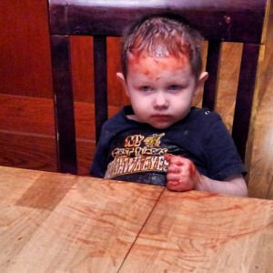 No, it's not blood.  Someone had fun with the ketchup while Mommy's back was turned.