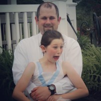 Gotta love silly father-daughter pictures. She makes the best faces. :)