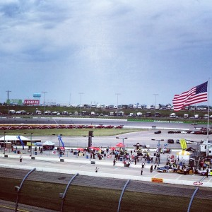 Qualifying laps.  If you look under the flag, you'll see a truck.