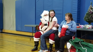 Someone said she was NOT going to sit on Santa's lap. Guess how well that worked out. :)
