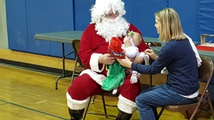 """Santa, you're kinda scary, but you gave me a dolly, so I don't know what to think now."""